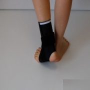 Ankle brace with bilateral stabilization, open front design